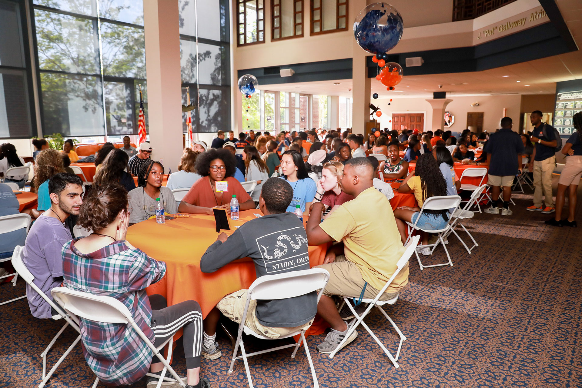 Students seated at tables during the Tiger Retreat event in 2019